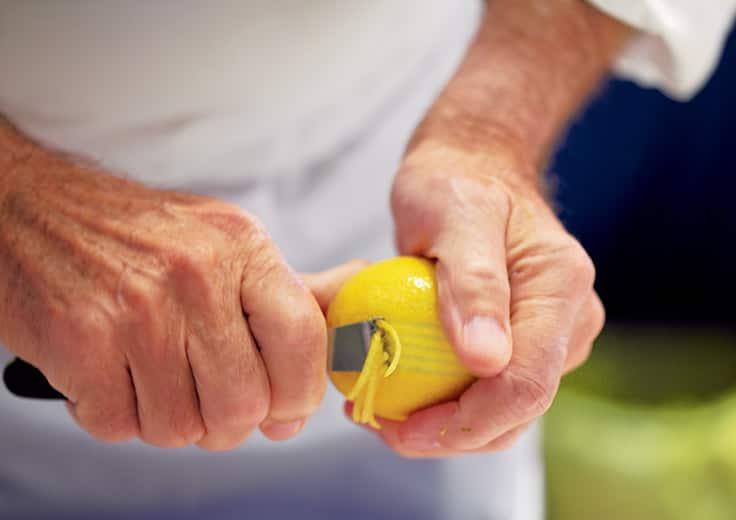 Chef peeling lemons